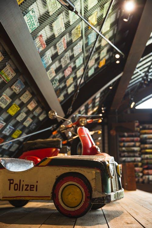 Wooden toy car in light garage