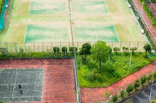 Drone view of shabby tennis court