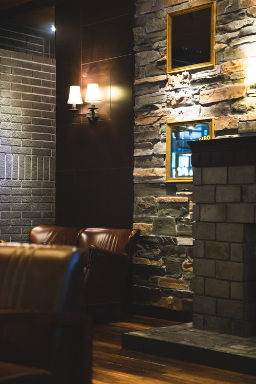 Interior of modern restaurant with stone walls and leather furniture