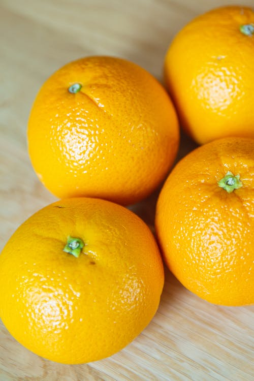 From above of similar tasty fresh tangerines with bright glowing peel and small pedicels