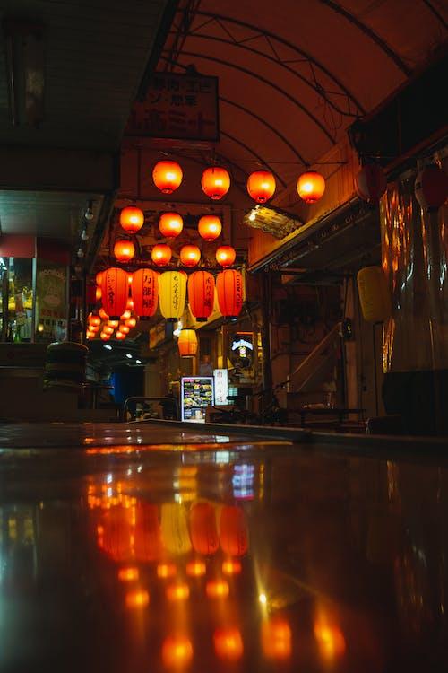 Illuminated street lamps in night street