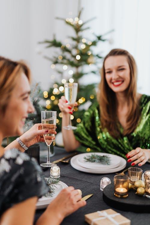Women Holding Glasses of Wine