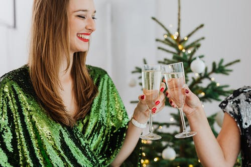 Smiling Woman Having a Toast with Her Friend