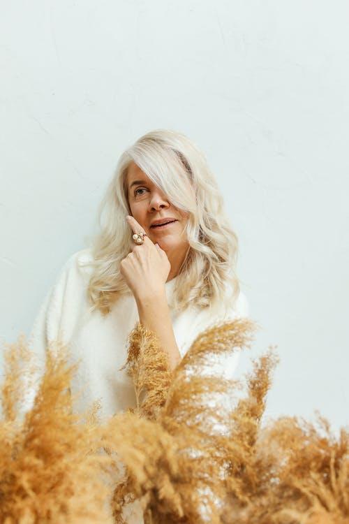 Elderly Woman Posing in White Background