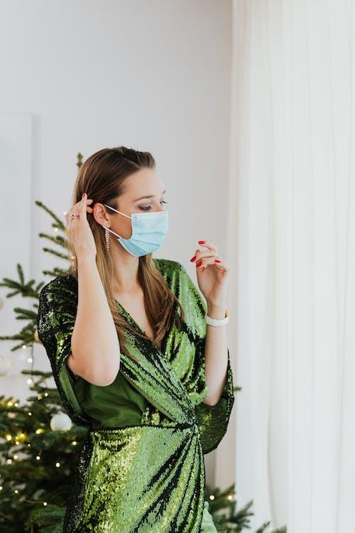 Woman in Green Dress Wearing a Face Mask