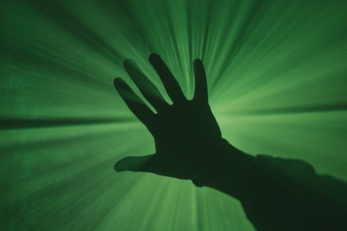Persons Hand With Green Light