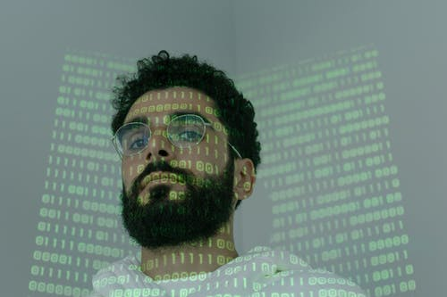 Man With Binary Code Projected on His Face