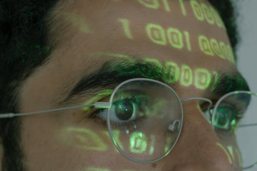 Person Wearing Silver Framed Eyeglasses
