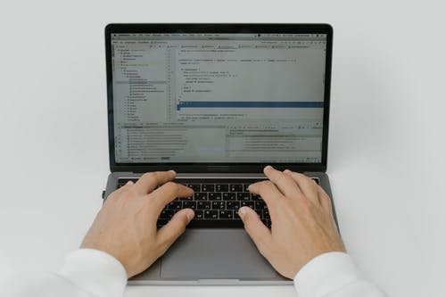 Hands on a Laptop Keyboard
