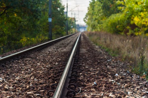 Free stock photo of depth of field, stones, train tracks