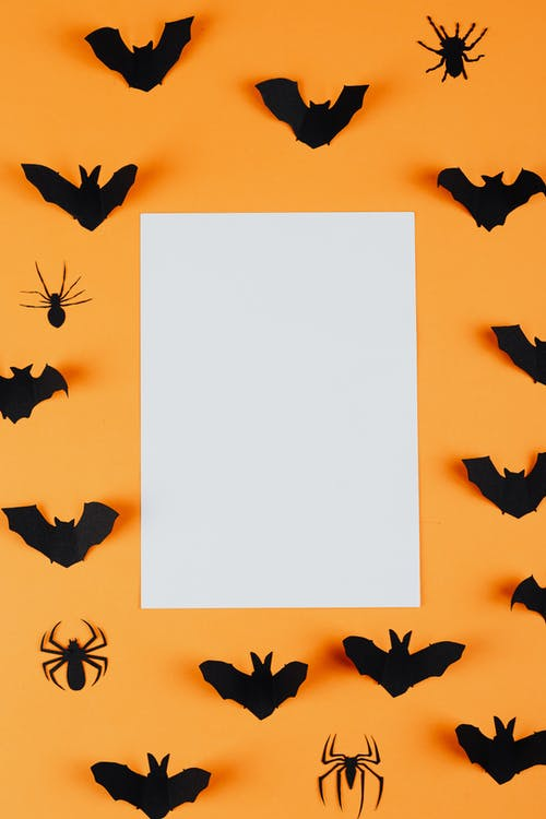 Paper Spiders and Bats on an Orange Background