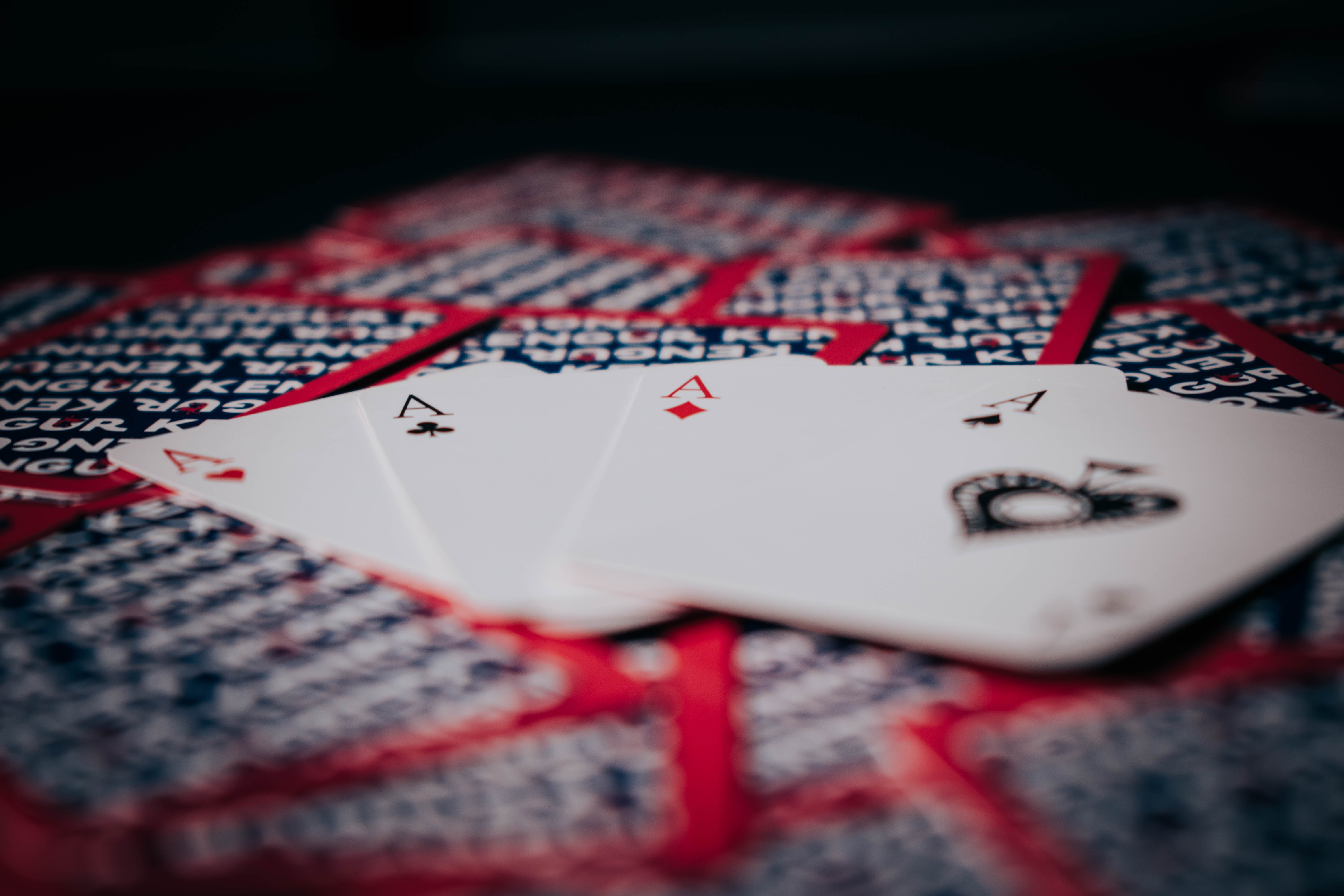 Playing Cards on Red and White Textile