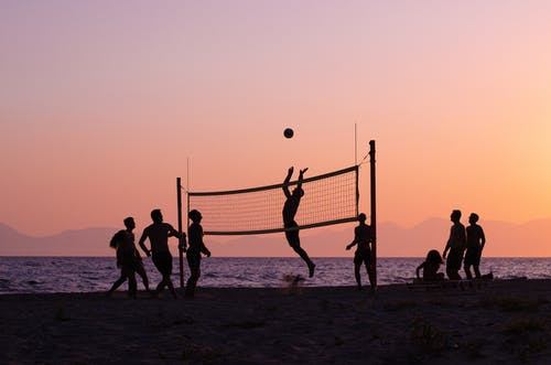 Silhouette of People Playing Volleyball during Sunset