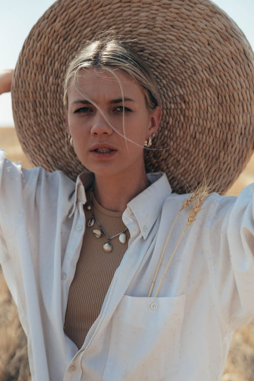 Peaceful woman with straw hat