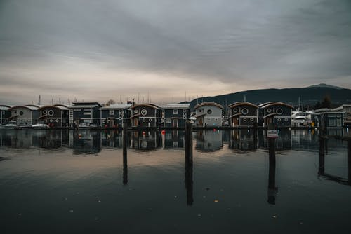 Small dock houses above calm water