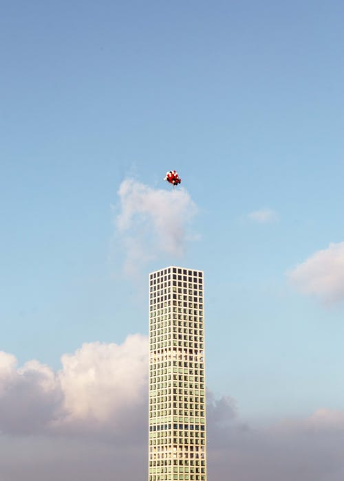 Detail of modern skyscraper 432 Park Avenue against cloudy sky with balloons