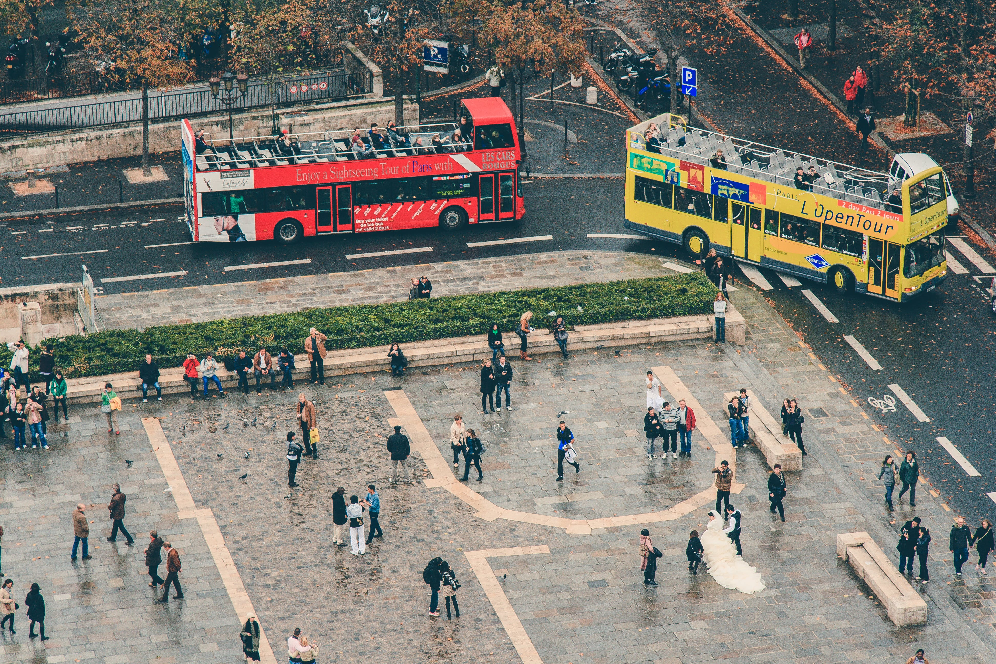 Red and Yellow Double Decker Buses on the Road