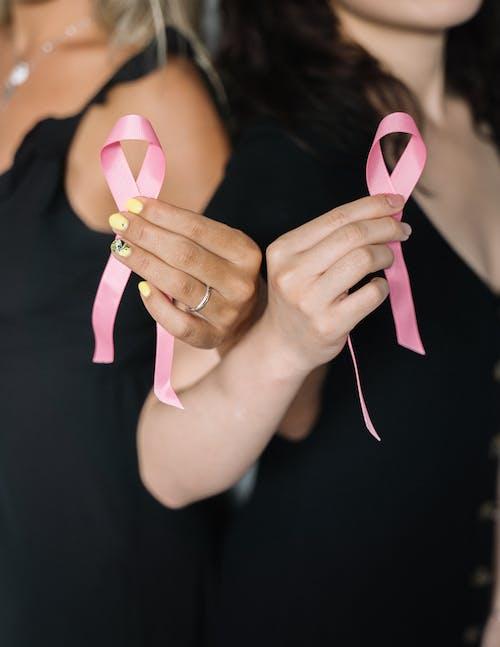 2 Women Holding Pink Ribbons