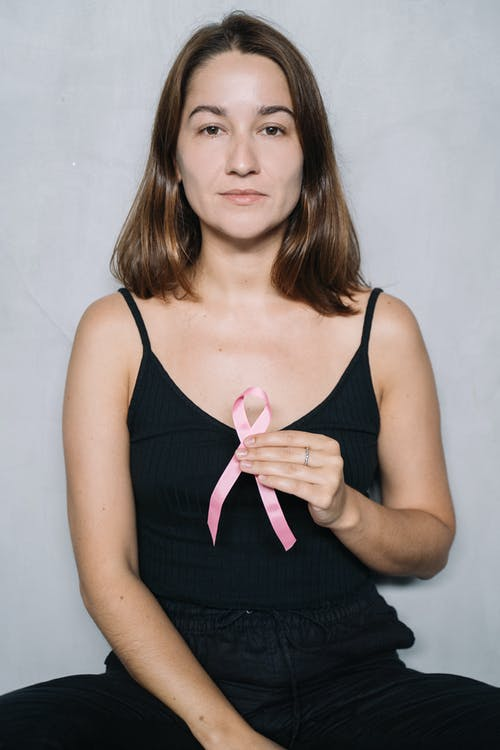 Woman in Black Top Holding Pink Ribbon
