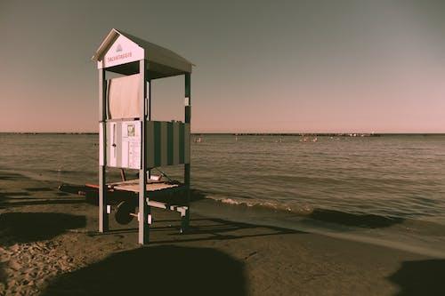 Small lifeguard house on sandy beach