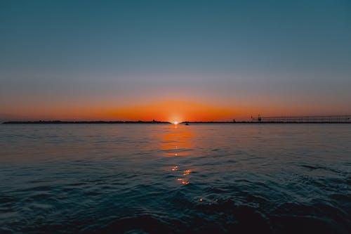 Waving sea against spectacular sunset sky