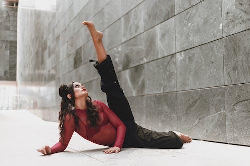Young flexible woman lying with raised leg