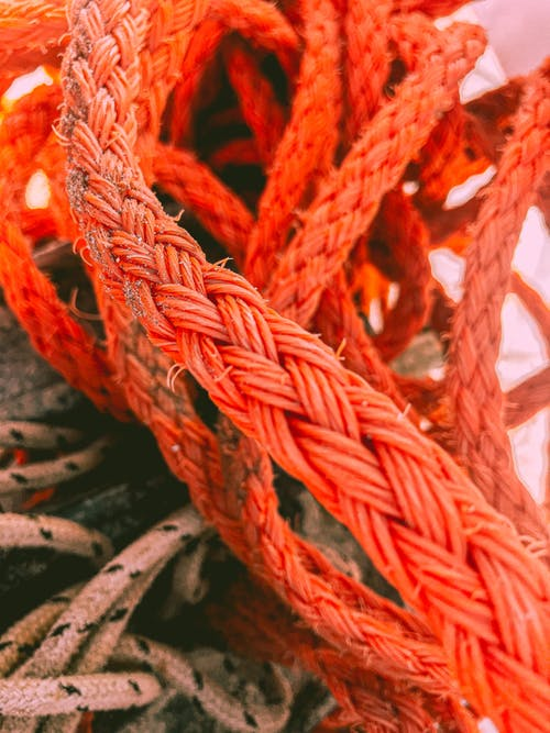 Bunch of various nautical strong ropes made of twisting together strands of natural fibers