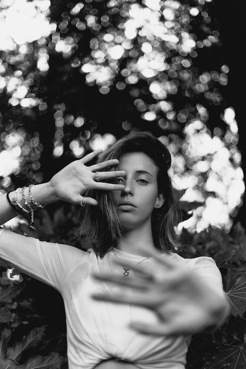 Sad young woman showing palms to camera
