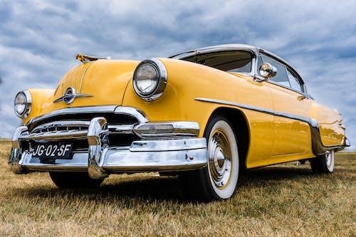 Yellow Classic Car on Green Grass Field