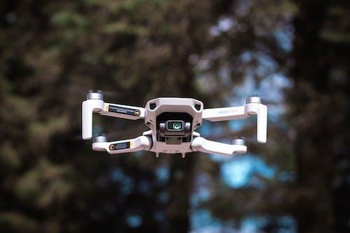 White and Black Drone in Tilt Shift Lens