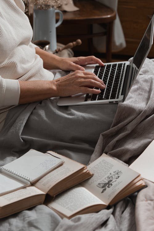 Person In White Dress Shirt Using Macbook Pro