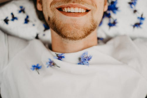 Man in White and Blue Floral Shirt