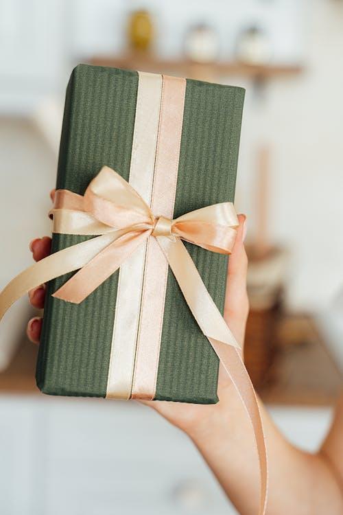 Green Gift Box With Peach Ribbon