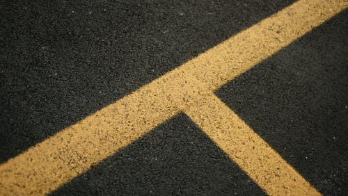 Black and Yellow Concrete Road