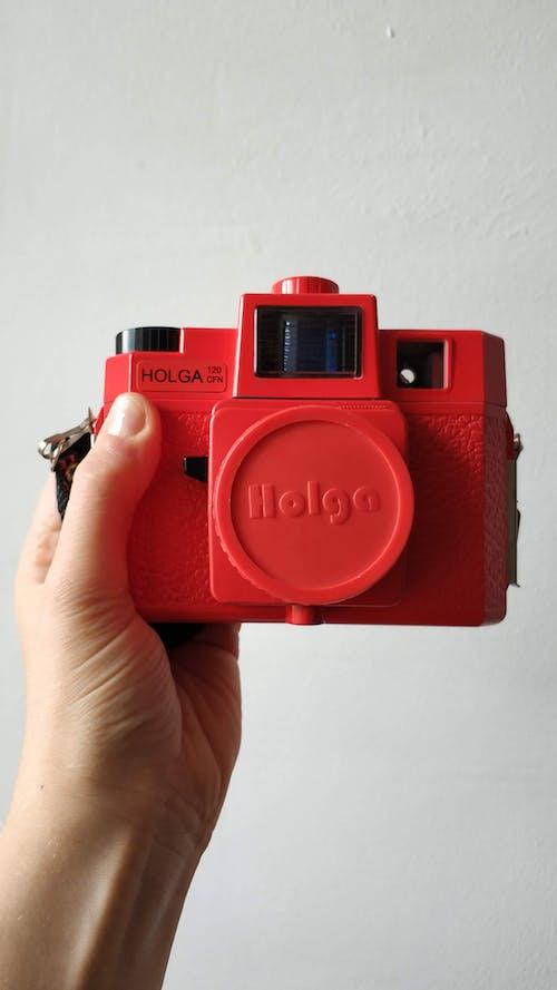 Red and Black Nikon Dslr Camera