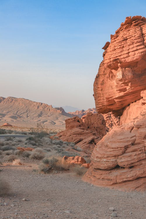 Canyon with huge rocky formations located on dry ground in semidesert against blue sky in daylight in nature in summer