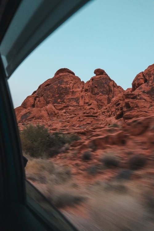 Rocky formations through window of car