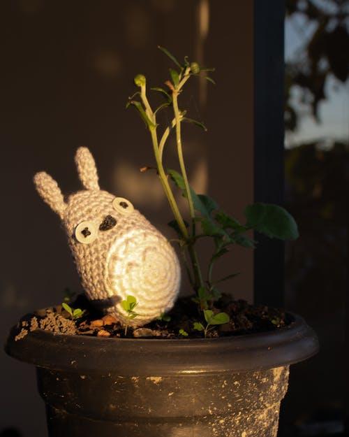 White Sheep Figurine on Brown Pot