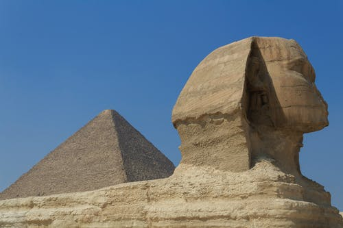 Brown Concrete Pyramid Under Blue Sky