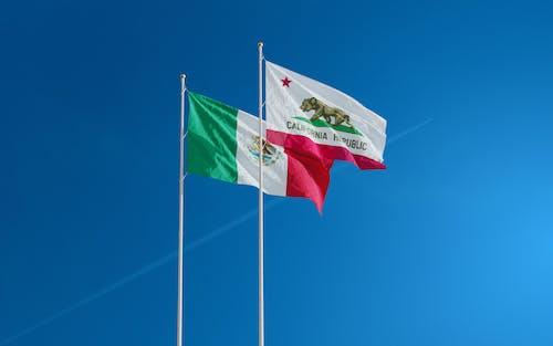 Fotos de stock gratuitas de astas de bandera, banderas, California