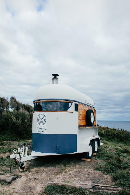 White trailer on grassy embankment