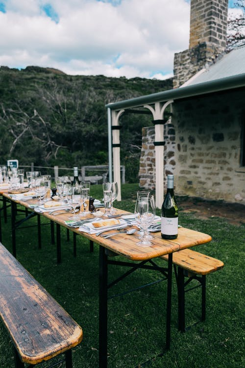 Served table on backyard of stone house