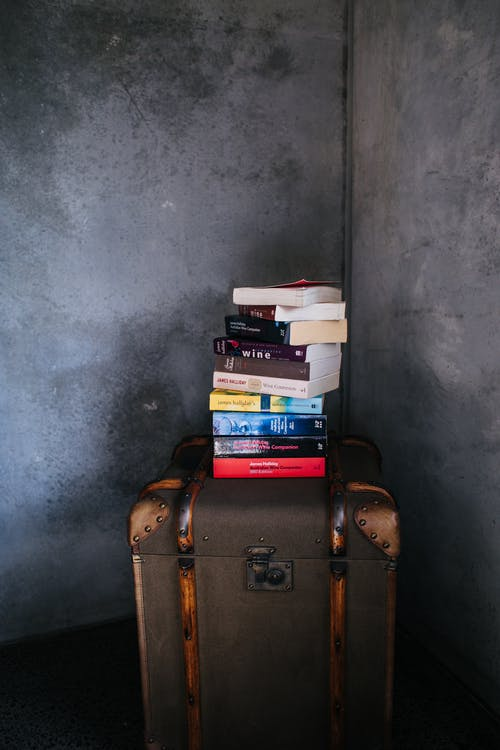 Pile of books on vintage suitcase