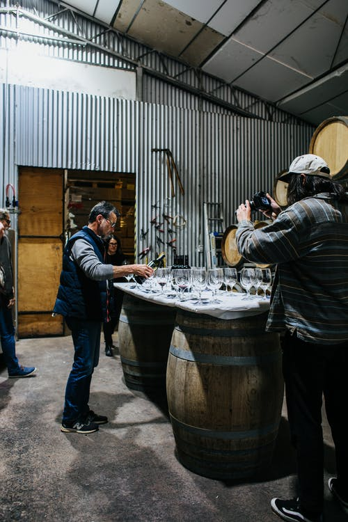 Sommelier pouring wine in winery
