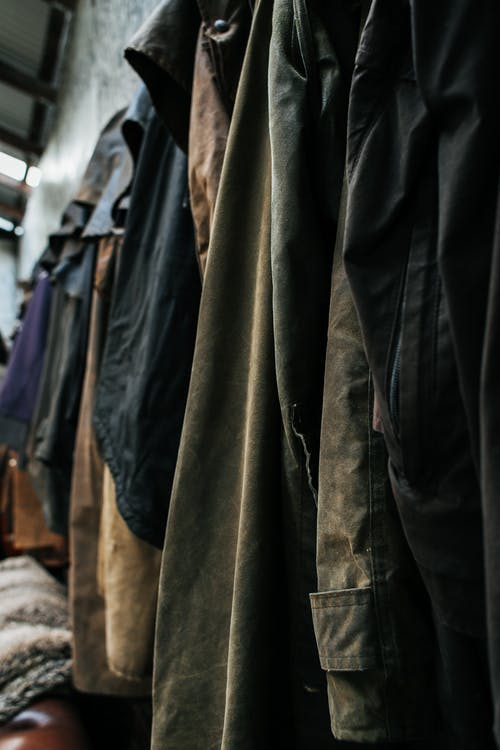 Various clothes hanging at wall