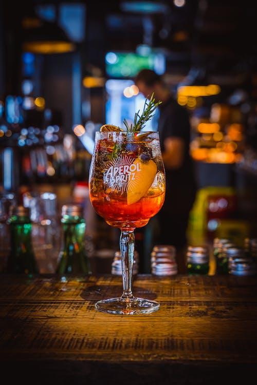 Clear Wine Glass With Orange Liquid Inside