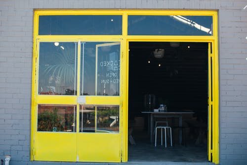Bright yellow entrance of modern cafe