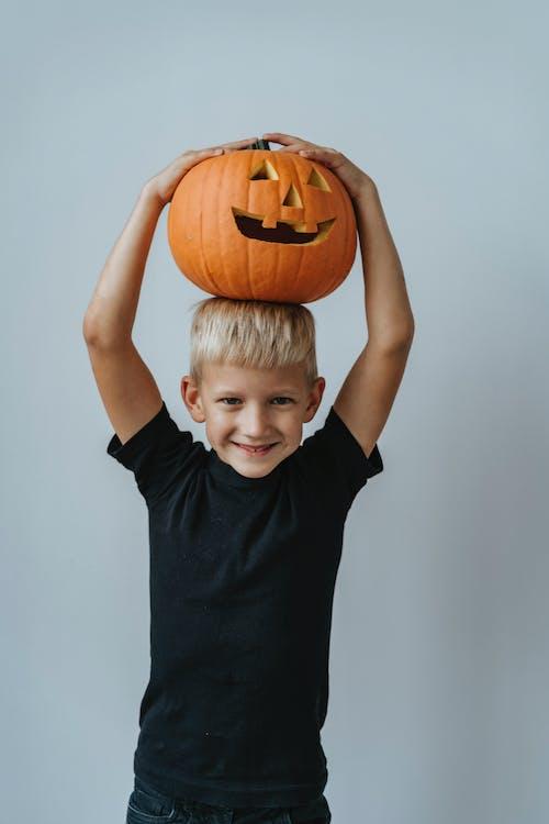 Boy Holding Jack O Lantern