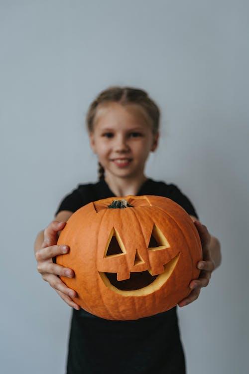 Girl Holding a Jack O Lantern
