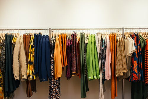 Multicolored clothes hanging on rack